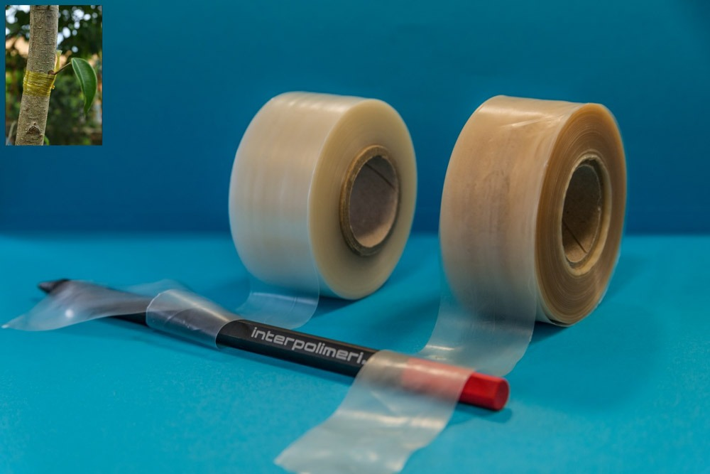 Two rolls of plastic film wrapping a felt-tip pen